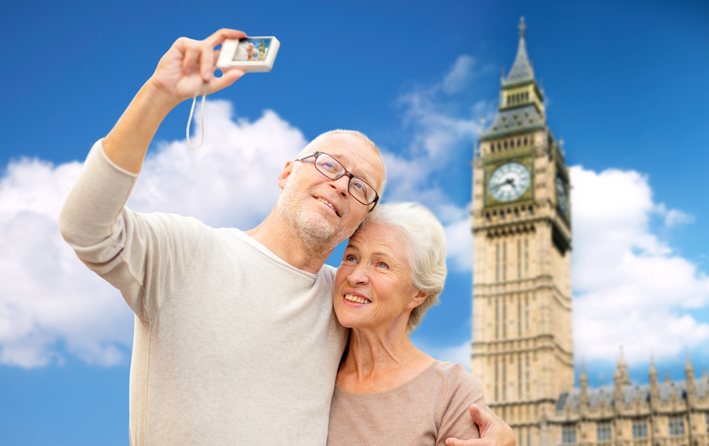 Older Couple on accessible holiday taking a selfie